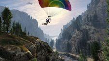 Паря с парашютом над лесом